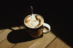 Delicious aromatic brewed whipped with icecream coffee in a bro. Wn cup with a heart royalty free stock photo