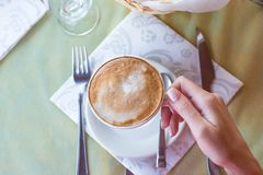 Delicious, aromatic cappuccino for breakfast at a. Cafe stock image