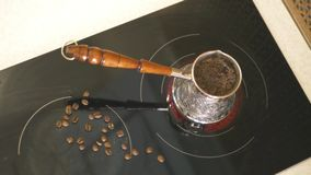 A delicious aromatic coffee is on the stove brewed. 4k, 3840x2160. HD stock video footage