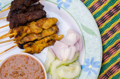 Delicious Asian Cuisine Chicken and Beef Satay. On plate Stock Photos