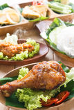 Delicious Asian food nasi ayam penyet. Delicious nasi ayam penyet with sambal belacan. Fried chicken rice with overhead view. Famous traditional Indonesian food royalty free stock photo
