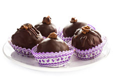 Delicious assorted dark chocolate truffle candies on a white pla Royalty Free Stock Photography