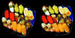 Sets of suhi in plastic trays stock photography