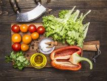 Delicious assortment of farm fresh vegetables on a cutting board wooden rustic background top view close up Stock Photos