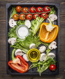 Delicious assortment of farm fresh vegetables   wooden box wooden rustic background top view close up Royalty Free Stock Image