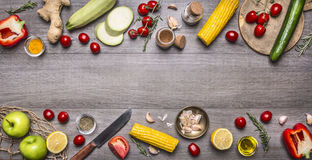 Delicious Assortment Of Farm Fresh Vegetables With Knife On Grey Wooden Background , Top View. Vegetarian Ingredients For Cooking.