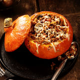Delicious autumn recipe for stuffed pumpkin Royalty Free Stock Image
