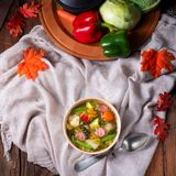 Delicious autumnal vegetable soup with sausage and bacon royalty free stock images