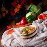 Delicious autumnal vegetable soup with sausage and bacon royalty free stock photo