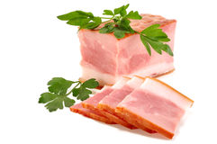 Delicious bacon with parsley leaves Royalty Free Stock Images