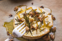 Delicious baked camembert with honey, walnuts, herbs and pears Royalty Free Stock Photography