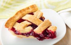 Delicious baked cherry pie on white plate. Pie delicious baked cherry table red background stock photos