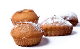 Delicious baked muffins on a white background Royalty Free Stock Images