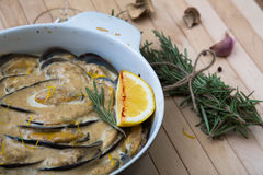 Delicious baked mussles with cream sauce. mushrooms and rosemary Stock Image