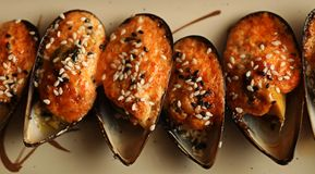 Delicious baked mussles Stock Images