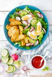 Delicious baked potato, boiled egg and fresh vegetable salad of lettuce, cucumber and radish. Summer menu for detox diet. Top view stock photography