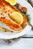 Delicious baked salmon with lemon Stock Photo