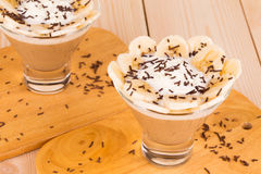 Delicious banana dessert on wood table. Royalty Free Stock Photography