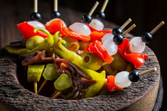 Delicious banderillas with peppers, olives and anchovies for spanish corrida. Closeup of delicious banderillas with peppers, olives and anchovies for spanish Royalty Free Stock Image