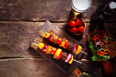 Delicious bar lunch of fresh vegetarian kebabs. Delicious bar lunch of fresh vegan or vegetarian kebabs with assorted roasted colorful vegetables on skewers Stock Photography