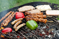 Delicious barbecue. A grill full of meat and vegetables Royalty Free Stock Photos