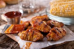 Barbecue Grilled Chicken Wings. Delicious barbecue grilled chicken wings with sauce and corn on the cob royalty free stock photography