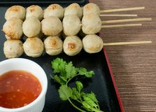 Delicious Barbecue Meat Ball with Sweet Spicy Sauce. Food and Cuisine, Grilled Meatballs on Wooden Skewer Served with Spicy Sauce and Green Coriander Royalty Free Stock Photography