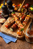 Delicious barbecued or grilled meat kebabs royalty free stock photography