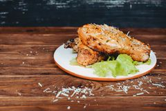 Delicious barbecued pork ribs served on lettuce on an old rustic wooden board Stock Images