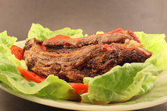 Delicious barbecued ribs on the grill Royalty Free Stock Photography