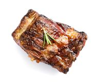 Delicious barbecued ribs with rosemary on white background. Top view royalty free stock image
