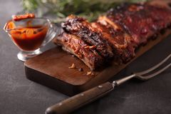 Delicious barbecued ribs seasoned with a spicy basting sauce royalty free stock photo