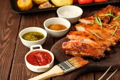 Delicious barbecued ribs seasoned with a spicy basting sauce and stock photos