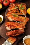 Delicious barbecued ribs seasoned with a spicy basting sauce and royalty free stock photo