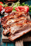 Delicious barbecued ribs seasoned with a spicy basting sauce Royalty Free Stock Photos