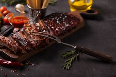 Delicious barbecued ribs seasoned with a spicy basting sauce royalty free stock image