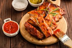 Delicious barbecued ribs seasoned with a spicy basting sauce and stock image