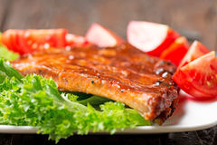 Delicious barbecued ribs seasoned with a spicy BBQ basting sauce Stock Photo
