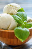 Delicious basil ice-cream in a wooden bowl. Royalty Free Stock Photography