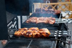 delicious bbq kebab grilling on open grill, outdoor kitchen. food festival in city. tasty food roasting on skewers, food-court. royalty free stock photos