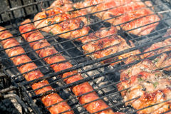 Delicious bbq kebab grilling on open grill, outdoor kitchen. tasty food roasting on skewers, food-court. summer picnic.  Stock Photos