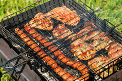 Delicious bbq kebab grilling on open grill, outdoor kitchen. tasty food roasting on skewers, food-court. summer picnic.  Stock Photography