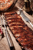 Delicious BBQ ribs with coleslaw on wooden table Royalty Free Stock Photo