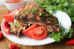 Delicious BBQ ribs with herbs Royalty Free Stock Images