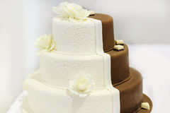 Delicious beautiful wedding cake in white and brown. Stock Photography