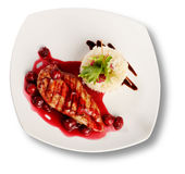 Delicious beef with cherry sauce. File includes clipping path for easy background removing Royalty Free Stock Photo