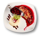 Delicious beef with cherry sauce. File includes clipping path for easy background removing Stock Image