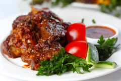 Delicious beef goulash with greens and vegetables Stock Photos