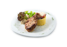 Delicious beef meals includes steak, sausages, salad, hominy Royalty Free Stock Image