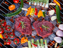 Delicious beef meat with vegetable on a barbecue grill. Assorted delicious beef meat with vegetable on a barbecue grill Royalty Free Stock Photo